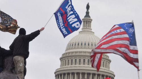 Close up of Capitol with Trump and America flag in the wind